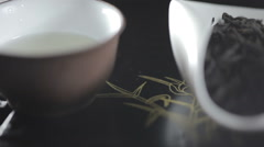 Close up shot of black tea leaves pile on white scoop - stock footage