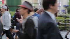 Pedestrians walking at zebra crossing in Ikebukuro, Tokyo, Japan Stock Footage