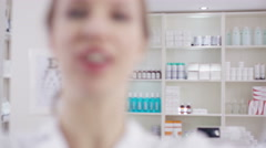 4K Optician puts a pair of glasses on a patient, as seen from patient's pov. - stock footage