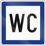 Slovenian service road sign - Public restrooms - stock illustration