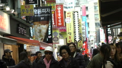 People shopping at Myeongdong street in Seoul city Korea  Stock Footage