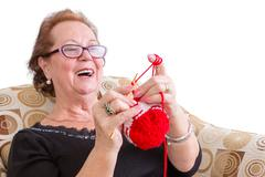 Happy elderly lady enjoying a joke Stock Photos