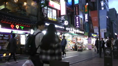 People shopping at Myeongdong street at night in Seoul, South Korea Stock Footage