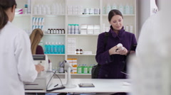 4K Workers serving customers in a chemist shop - stock footage