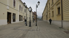People walking on one of the old town's streets in Baia Mare Stock Footage