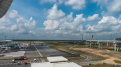 Clouds time lapse and aeroplanes taxiing to terminal at Kuala Lumpur Internation Stock Footage