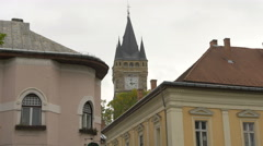 Stephen's Tower seen between two buildings in Baia Mare - stock footage