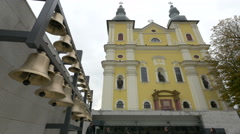 People walking by the Castle Square bells in Baia Mare Stock Footage