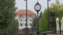 View of a woman's statue and the Miner hotel in Baia Mare Stock Footage