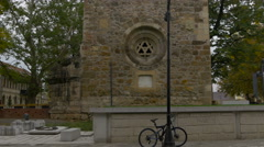 Bike parked near Stephen's Tower in Baia Mare Stock Footage