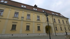 Walking near a yellow building in Baia Mare Stock Footage