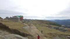 Walking on a mountain road next to Babele, Bucegi Mountains Stock Footage