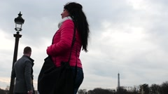 Woman standing  in Paris Champs Elysees time lapse Stock Footage