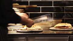 Non identify Chef made pizza baking in kitchen Stock Footage
