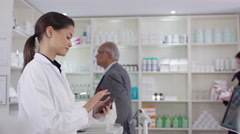 4K Workers having discussion & customers browsing in a chemist shop - stock footage