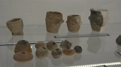 Vessels and other archaeological pieces in the museum of Fagaras fortress Stock Footage