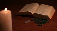 An open bible with a rosary Stock Footage