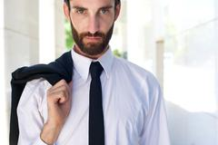 Stock Photo of Male fashion model standing outdoors with shirt and tie