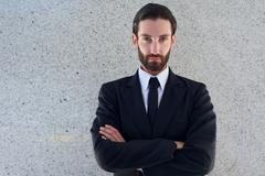 Handsome young man in black business suit - stock photo