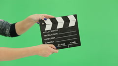 Hand girl with clapperboard on the green screen Stock Footage