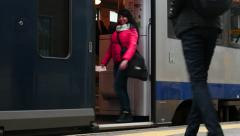 woman go to train doors and waiving , doors closing - stock footage