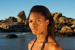 Young african american woman standing at the beach Stock Photos