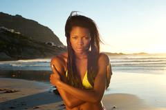 Beautiful young african american woman at the beach Stock Photos
