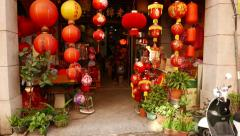 Small building entrance, decorated with many paper chinese lantern lamps Stock Footage