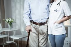 Elder man and his nurse Stock Photos