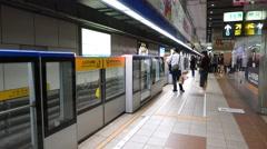 Modern underground station, glass fence at platform side, blink light - stock footage