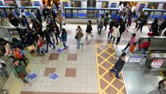 Metro platform from top, passengers alight from train, crowd movement Stock Footage