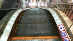 Escalator stairs move upward, slide on camera, top of moving staircase Stock Footage