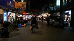 Dark street of Taipei in the night, POV walk forward, stalls and marketing Stock Footage