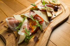 Italian prosciutto, cured pork meat - stock photo