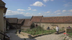 Tourists at the interior courtyard at Rasnov Citadel Stock Footage