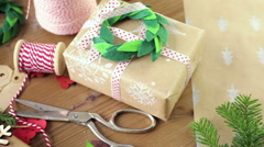 Wrapping Christmas gifts in recycled brown paper with vintage style at home. Stock Footage