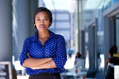Confident young african american woman standing in the city Stock Photos