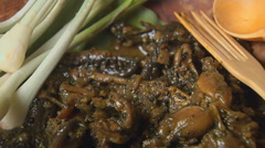A meal of Rice and Frogs cooked indian style Stock Footage