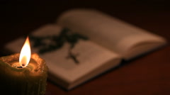 An open blurry bible with a rosary Stock Footage