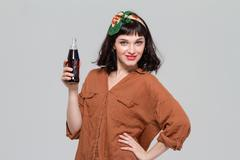 Attractive confident woman posing with  bottle of sweet carbonated beverage Stock Photos