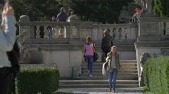 Tourists walking in the garden of Peles Castle Stock Footage