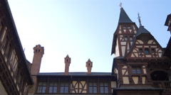 Chimneys seen from the inner yard of Peles Castle Stock Footage