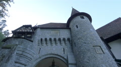Stone wall with gate and tower near Peles Castle Stock Footage