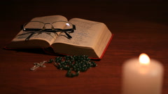 An open bible with a closed glasses Stock Footage