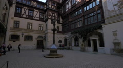Tourists visiting the interior courtyard of Peles Castle Stock Footage