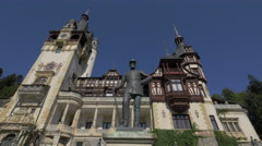 Imposing King Carol I statue in front of Peles Castle - stock footage