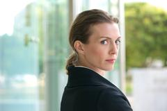 Close up portrait of an attractive profession business woman - stock photo