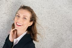 Close up portrait of a happy business woman laughing expressing positivity - stock photo