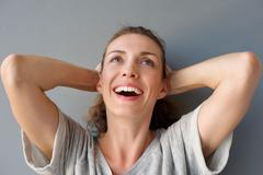 Carefree happy woman laughing with hands in hair Stock Photos