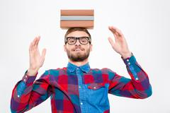 Happy amusing man in glasses with books on his head Stock Photos